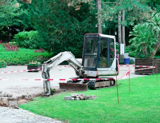 Small Excavator Working In The Park